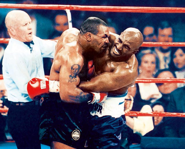 In the much-anticipated rematch of their unforgettable 1996 heavyweight title fight, Tyson savagely bit Holyfield on the right ear to earn a two-point deduction from referee Mills Lane. When Tyson followed it up moments later by biting Holyfield's left ear, Lane had no choice but to disqualify the former champ. Tyson was fined $3 million and had his boxing license revoked by the Nevada State Athletic Commission.