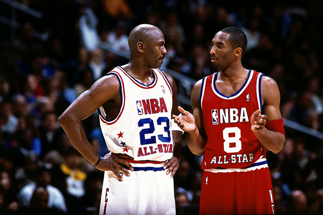 From 1997-2001, the NBA didn't have special All-Star uniforms. Each player on the home team would wear their own white jersey, the away team would wear their road colors. The league went back to All-Star unis in 2002. Here's a young Kobe and an old MJ. Maybe they're talking about their sweet retro jerseys, but more likely Kobe is complaining that he doesn't get enough shots.