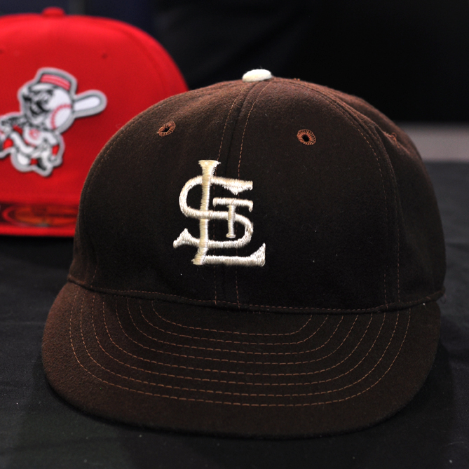 This cap was worn by the St. Louis Browns in 1953, the year before the team moved to Baltimore and became the Orioles.                                      But more than a relic of a bygone team, this hat could very well be called the prototype of New Era's signature 59Fifty cap. It's a six-panel fitted wool cap with a leather headband, visor embroidery, and dark green coloring under the brim -- all elements that would become hallmarks of the 59Fifty when it debuted in 1954.