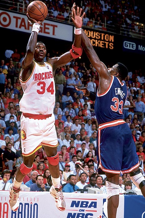 Olajuwon outplayed Patrick Ewing in the seven-game 1994 Finals, averaging 26.9 points, 9.1 rebounds and 3.9 blocks. He became the only player in NBA history to win MVP, Defensive Player of the Year and Finals MVP in the same season. In the '95 Finals, Olajuwon bested Shaquille O'Neal and the Magic. Olajuwon outscored Shaq in every game in the sweep, averaging 33 points, 10.3 rebounds and 2.8 blocks.