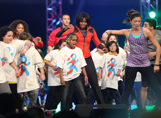 With the help of some star athlete friends, First Lady Michelle Obama got more than 6,000 Chicago school children on their feet as she introduced her latest program, Let's Move! Active Schools last February.