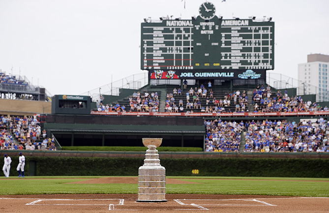 The Stanley Cup trophy sits on the home plate before a baseball game between the Pittsburgh Pirates and the Chicago Cubs in Chicago, Saturday, July 6, 2013.