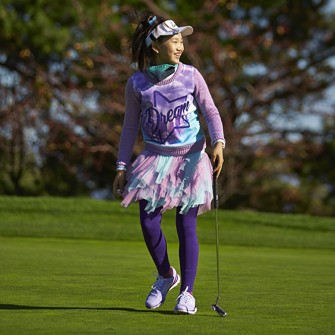 Lucy made history last summer when she became the youngest player to compete in the U.S. Women's Open. At the age of 11, she shot 78 (eight over par) in both of her rounds. In addition to her great play, she drew attention for her style in clothes and her love of ice cream, which she snacked on during her press conference after the second round.