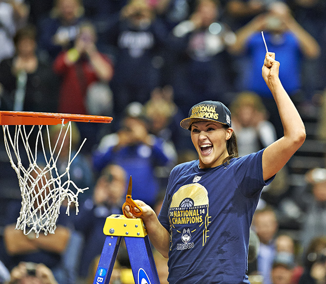 Stefanie Dolson (left) and the Connecticut Huskies just won the 2013--14 national title. Get out the ladders and the scissors, people. It's time to cut down the nets! This tradition began in basketball-mad Indiana at the state championship in the 1920s. It's an inclusive ritual during which each member of a program snips a piece of the net after winning a title. Most even do it after winning a regional during the NCAA tournament, though some teams get superstitious and wait for the bigger win.
