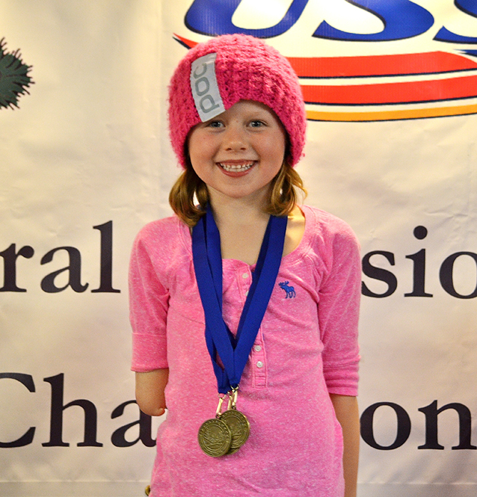 Eight-year-old Audrey Crowley becomes Wisconsin Junior Racing's overall girls champion after winning four of six races within her age group. Audrey, who has been skiing since she was three, was born without a lower right arm and uses a prosthetic and pole attachment to navigate her way down the slopes.