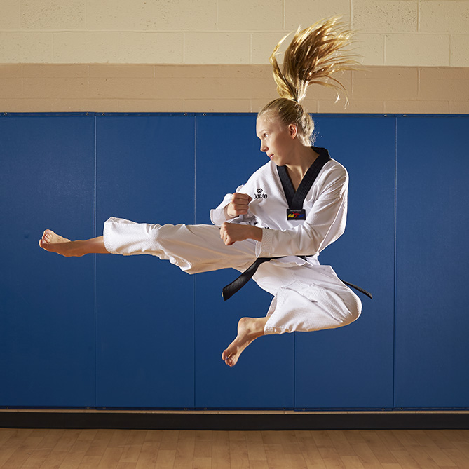 "Two things are clear when watching 11-year-old Natalie train: She is extremely talented, and she enjoys the sport of taekwondo. ""You have to appreciate how much fun she's having in a hard workout, in a hard match — even though she doesn't have many of those,"" says national AAU coach Arlene Limas, who has worked with Natalie for three years. ""Already at a young age Natalie is enjoying [the] process, and that's huge."" Also huge: Natalie's list of accomplishments. The sixth-grader won gold in her black belt division this year at the U.S. Open, the USAT National Championships, the AAU Taekwondo National Championships, and the Pan American Taekwondo Youth Opens, outscoring opponents at the events 198–42. She speaks to Girl Scout troops, athletic clubs, and community organizations about the importance of hard work and following your dreams, and she also teaches free youth martial arts classes. Since last winter she has sold more than 1,000 copies of the inspirational book she self-published to help pay for training, Tough Girls Finish First. (She's also releasing a second book, Kick It Fit with Natalie.) ""A lot of girls think they can't do as well as boys, and that stereotype is not really true,"" she says. ""I just thought, Why not convince them that they can do anything?"""