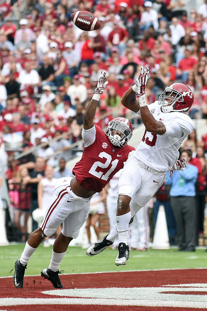 ArDarius Stewart #13 of the White team catches a touchdown pass in front of Maurice Smith #21 of the Crimson team during the University of Alabama A Day spring game at Bryant-Denny Stadium on April 18, 2015 in Tuscaloosa, Alabama.