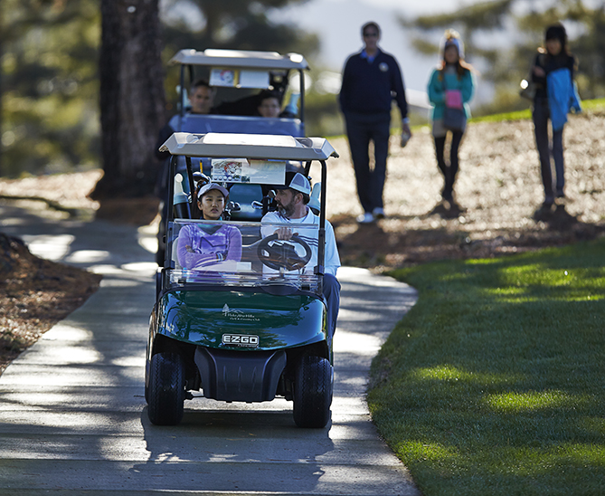 There's one thing I can definitely do better on the golf course than Lucy: drive a cart. Since she's under 16, she has to ride shotgun.