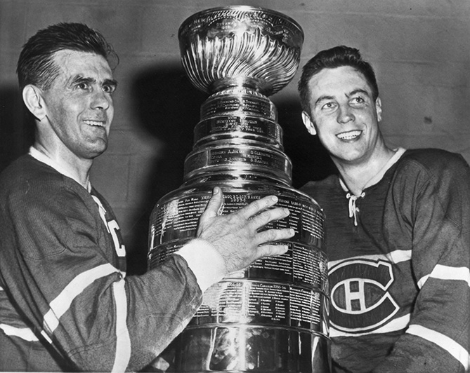 Beliveau won his first Stanley Cup in 1956. He would win a total of 10 in his 20-year career. Here, Montreal Canadiens' Maurice Richard, left, and Beliveau pose with the Cup after beating the Boston Bruins in the 1958 Stanley Cup Finals. With Beliveau, the Habs won five-straight Cups from 1956-1960.