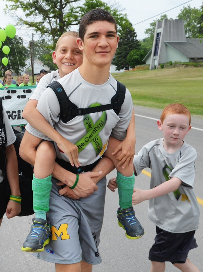 Siblings Hunter and Braden Gandee walk 57 miles together to raise awareness for cerebral palsy. The Cerebral Palsy Swagger took place across southern Michigan, ending at the University of Michigan. Hunter, 15, and eight-year-old Braden, who has cerebral palsy, did a similar 40-mile walk last summer.