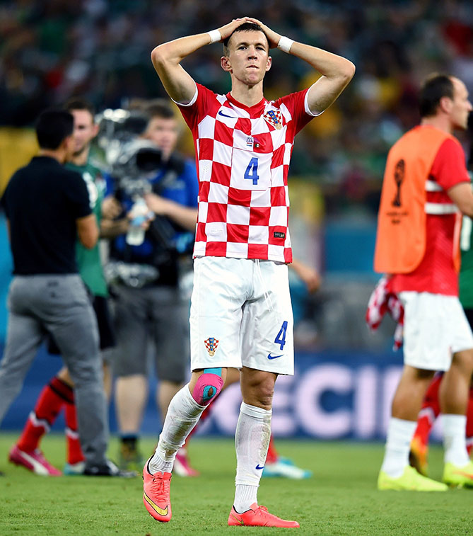 The red-and-white checkerboard pattern on Croatia's national soccer team jersey is inspired by the country's flag insignia — unfortunately, it looks more like a picnic table. Midfielder Ivan Perisic's expression says it all.