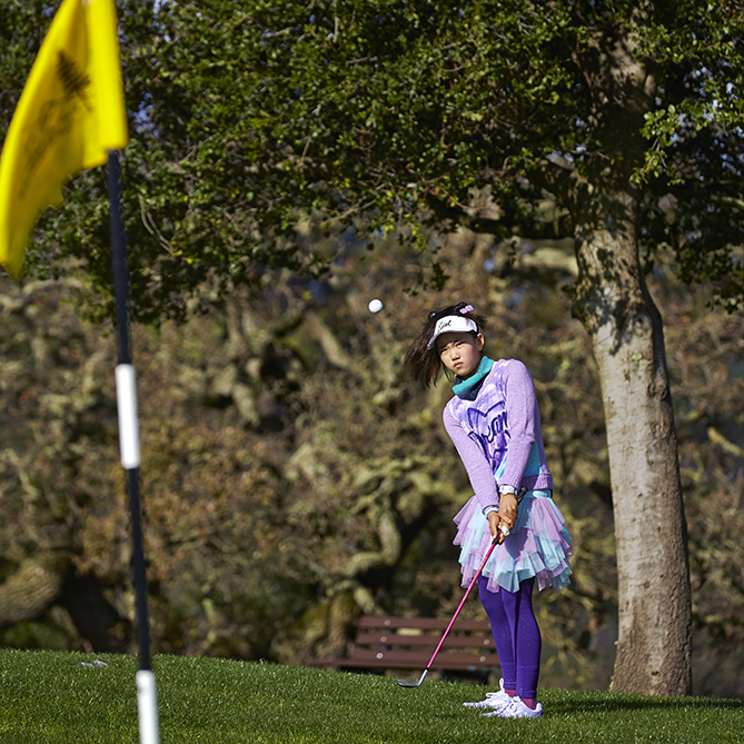 Lucy hits the ball far for a 12-year-old, but compared to grown-ups she's about average. She rarely makes mistakes, though, and when she does get in trouble, she's great at chipping back to safety. She made this chip for a birdie.