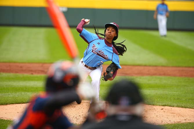 She pitches exclusively from the stretch, with a repeatable delivery — her arm is as loose as a rag doll's when she slingshots it forward, but it's always from the same arm angle and slot.