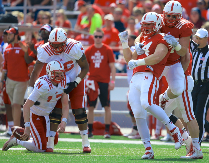 Red Team defensive end Mick Stoltenberg (44) and defensive lineman Logan Rath, right, celebrate after sacking White Team quarterback Ryker Fyfe, bottom left, during Nebraska's annual NCAA college football Red-White spring game in Lincoln, Neb., Saturday, April 11, 2015.