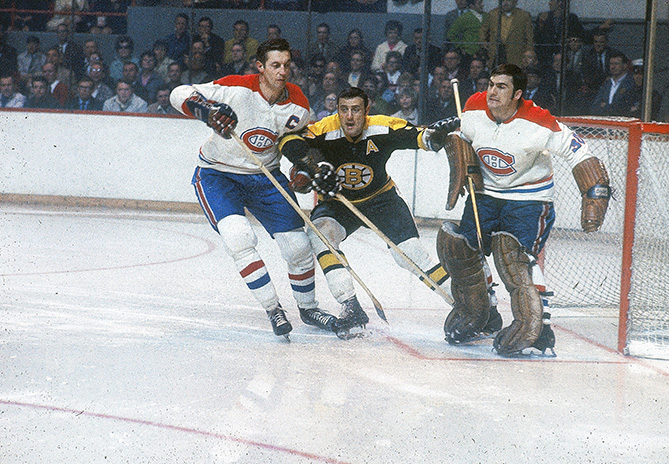 Beliveau (left) and goalie Rogatien Vachon defend vs. Boston Bruins star Phil Esposito in the NHL semifinals.