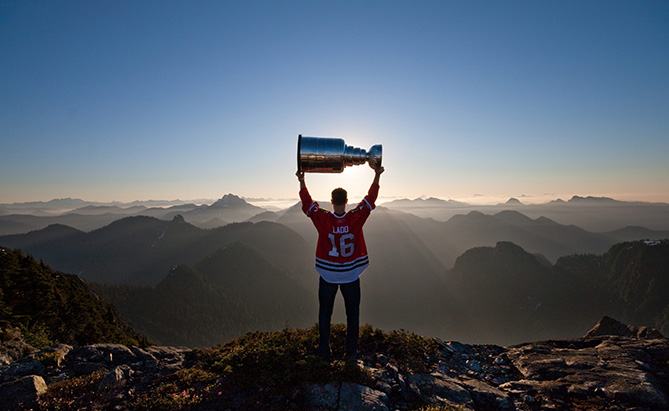 In this photo taken on Monday, July 19, 2010, Atlanta Thrashers forward Andrew Ladd, formerly of the Stanley Cup champion Chicago Blackhawks, spends his day with the Stanley Cup atop Crown Mountain, British Columbia., north of Vancouver. Ladd, a two-time Stanley Cup champion, was flown by helicopter to the top of Crown Mountain to watch the sunrise.