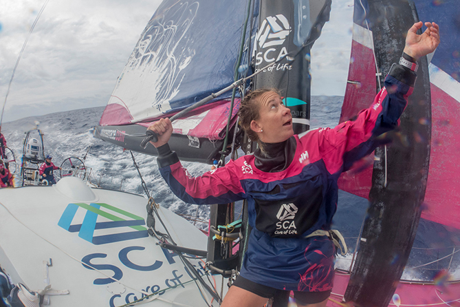 May 4, 2015. Leg 6 to Newport onboard Team SCA. Day 15. Sophie Ciszek sorts a halyard out during a sail change.