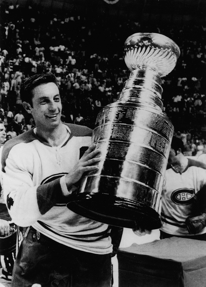 Beliveau holds up the Stanley Cup (his ninth) after defeating the St. Louis Blues in Game 4 of the 1969 Stanley Cup Finals on May 4, 1969, at the St. Louis Arena in St. Louis, Missouri.