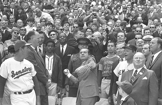 "President Nixon threw three first pitches and attended 11 games: eight in Washington, one in Cincinnati, and two in Anaheim. Nixon was a huge baseball fan, saying once that never leaves a game before the last pitch ""because in baseball, as in life and especially politics, you never know what will happen."" He was also a political animal: Before occupying the Oval Office, he was a Senator then Eisenhower's Vice President. And yet, he said, ""I don't know a lot about politics, but I do know a lot about baseball."" Nixon was such a baseball nut MLB Commissioner Bowie Kuhn gave him a ""Baseball's Number 1 Fan"" trophy."