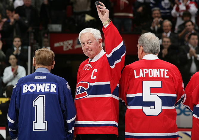 Jean Beliveau, formerly of the Montreal Canadiens, salutes the crowd prior to a game against the Toronto Maple Leafs as the teams salute their Original Six rivalry at the Bell Centre on January 8, 2009 in Montreal, Quebec, Canada. Beliveau died Dec. 2, 2014, at the age of 83.