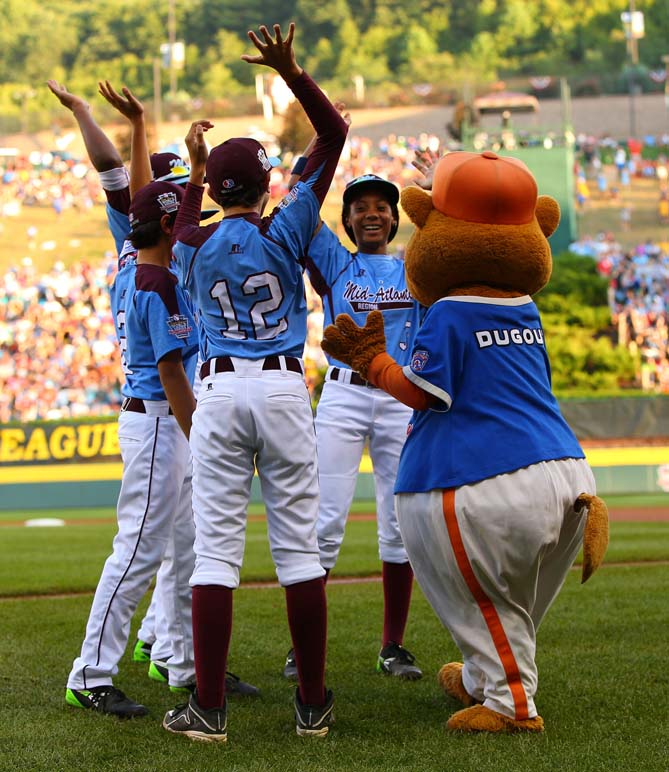 """One night the Taney players were forced to leave their dorm complex after a water-main break and move in with their parents at the hotel. Mo'ne was hanging out in her mom's room with teammate Zion Spearman, her best friend. """"We were joking, and we were laughing,"""" she says, and before they knew it, it was 1:30 in the morning. """"I kind of forgot we were here. It was just fun to hang out like normal, you know?"""""""