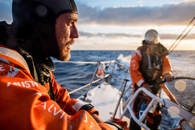 November 06, 2014. Leg 1 onboard Team Alvimedica. Day 26. The final 100 miles of Leg 1 prove to be the hardest on the heavy-air sprint into Cape Town. Nick Dana takes a breather before a pre-dusk sail change in building winds.