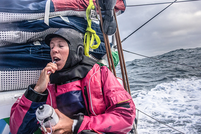 August 12, 2014. Round Britain Island Race Day 3 - OBR content Team SCA: Sam Davies finds a quite moment to brush her teeth.