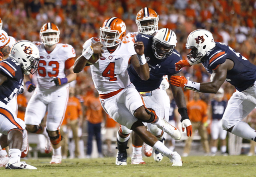 FILE - In this Sept. 3, 2016, file photo, Clemson quarterback Deshaun Watson, center, runs the ball in the first half during an NCAA college football game against Auburn, in Auburn, Ala. The AP college football  Player of the Year will be announced Tuesda