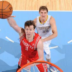 Rockets center Omer Asik (center) will reportedly be traded to the Pelicans.
