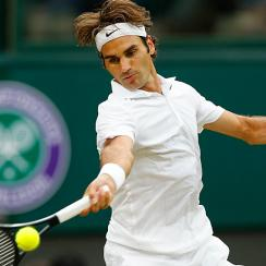 Roger Federer of Switzerland plays a return to Santiago Giraldo of Colombia.