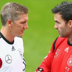 Germany national team fitness coach Shad Forsythe, right, talks to Bastian Schweinsteiger during training.