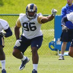 Michael Sam (center) could find himself the odd man out on a loaded Rams defense.
