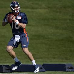 Broncos quarterback Peyton Manning practices at training camp.