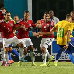 Colombia's wall braces for Neymar's free kick, which found the back of the net in a 1-0 Brazil win in last week's friendly.