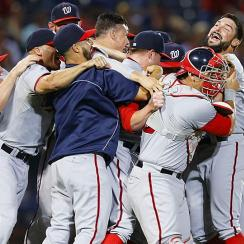The Washington Nationals celebrate their NL East title after shutting out the Braves on Tuesday night.