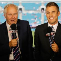 Taylor Twellman, right, will remain calling soccer for ESPN after signing an eight-year deal with the network.