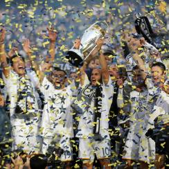 Landon Donovan lifts the MLS Cup trophy for a record sixth time after the LA Galaxy's 2-1 win over the New England Revolution in extra time.