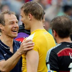 U.S. national team manager Jurgen Klinsmann greets Germany goalkeeper Manuel Neuer after their Group G finale at the 2014 World Cup.