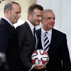 Almost a year ago, MLS commissioner Don Garber, left, joined David Beckham, center and Miami-Dade County Mayor Carlos Gimenez to announce an expansion franchise, contingent on a stadium in Miami.