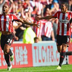 Jermain Defoe (left) celebrates his goal with Patrick van Aanholt