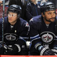 Dustin Byfuglien (right) gave reporters the Marshawn Lynch treatment on Tuesday.