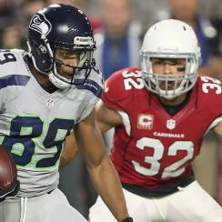 Wide receiver Doug Baldwin #89 of the Seattle Seahawks runs after the catch under pressure from free safety Tyrann Mathieu #32 of the Arizona Cardinals in the first quarter of the NFL game at the University of Phoenix Stadium on October 23, 2016 in Glenda