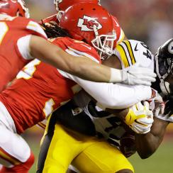 Wide receiver Antonio Brown #84 of the Pittsburgh Steelers is tackled by free safety Ron Parker #38 of the Kansas City Chiefs after a catch in the first quarter of the AFC Divisional Playoff game at Arrowhead Stadium on January 15, 2017 in Kansas City, Mi