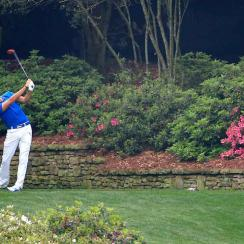 Rickie Fowler tees off during a practice round for the 2015 Masters.