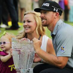 Hunter Mahan celebrates his 2014 victory at The Barclays with wife Kandi and daughter Zoe.