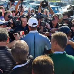 Tiger Woods talks to the media after withdrawing from the Farmers Insurance Open at Torrey Pines Golf Course on February 5, 2015.