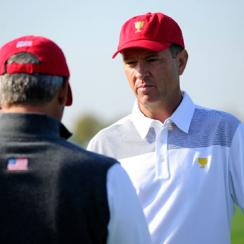 Assistant captain Davis Love III speaks with U.S. Team captain Fred Couples during a practice round prior to the start of the 2013 Presidents Cup