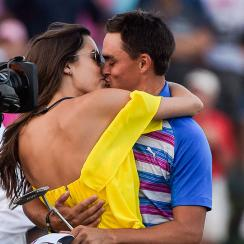 Rickie Fowler and Alexis Randock kiss after Fowler's victory at the Players Championship.