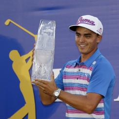 Rickie Fowler holds the Players Championship trophy Sunday in Ponte Vedra Beach, Florida.