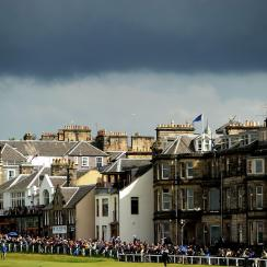 Golf fans watch the play along the 18th fairway during the first round of the 2010 Open Championship on the Old Course, St. Andrews.